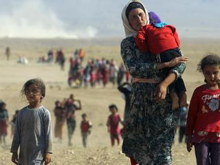 File photo of displaced people from the minority Yazidi sect, fleeing violence from forces loyal to