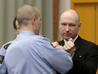 Mass killer Anders Behring Breivik has his handcuffs removed upon his arrival at the court room in S