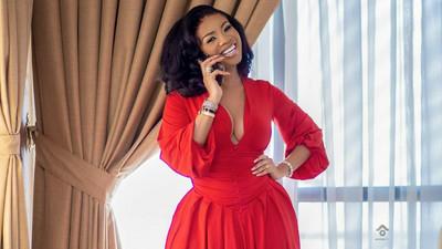 Serwaa Amihere showcases her enviable model body in a saucy red mini dress
