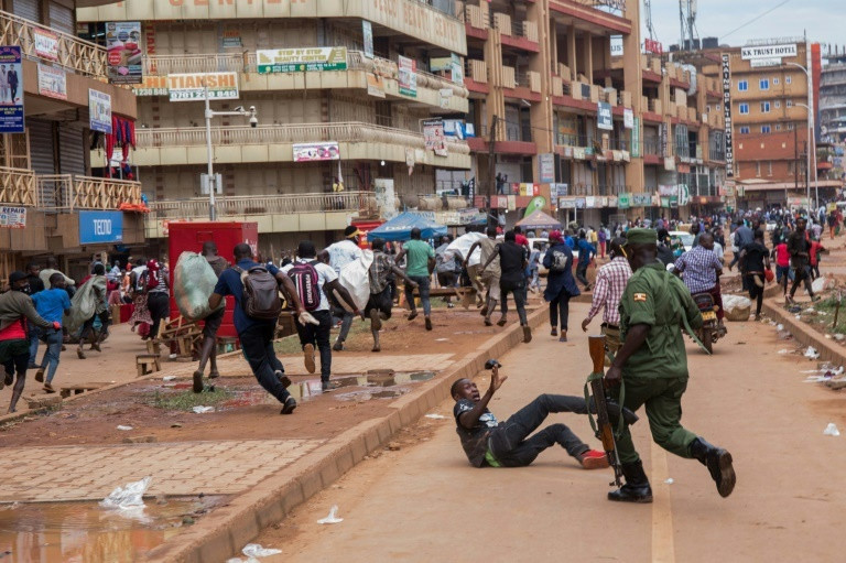 A police officer in Uganda dispersing a crowd.