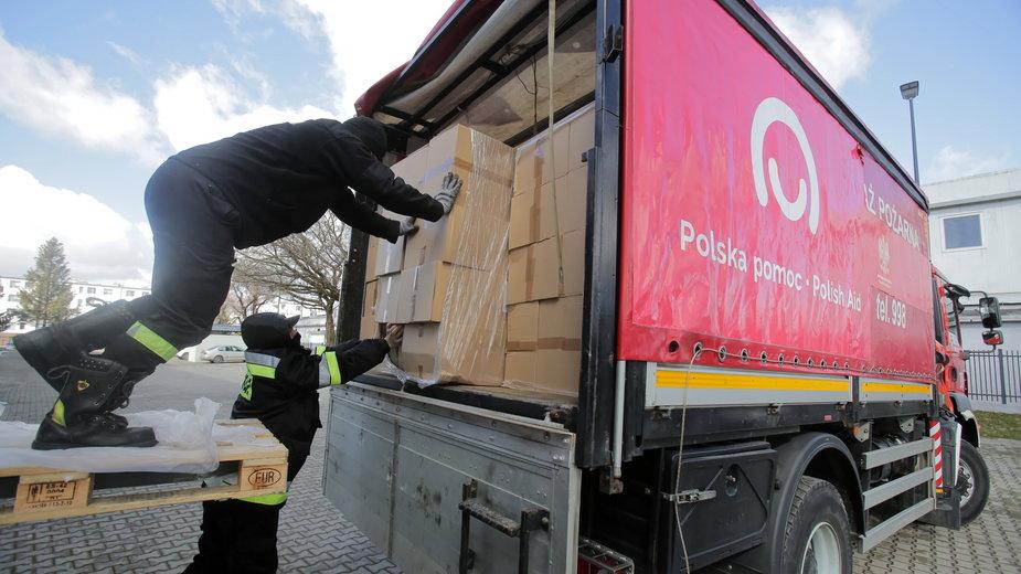 Wczorajsza akcja załadunku maseczek ochronnych w Olsztynie