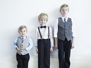 Brothers wearing suits indoors