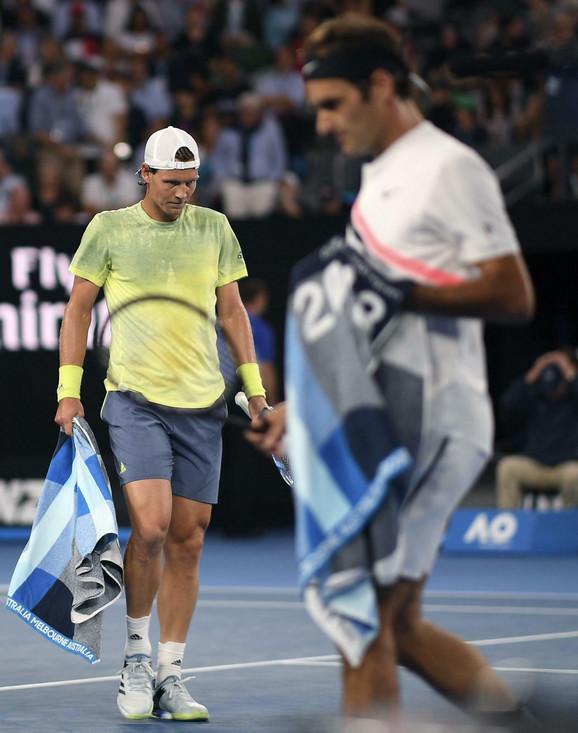 Tomaš Berdih i Rodžer Federer