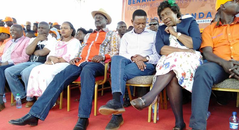 Maina Kamanda, Kivutha Kibwana,Anne Waiguru, Raila Odinga, Alfred Mutua and Charity Ngilu at a campaign rally for Bernard Imran Okoth in Kibra