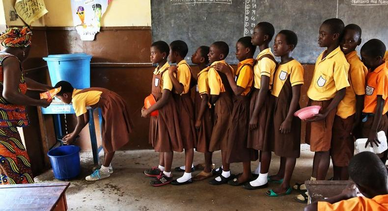 ___4322942___https:______static.pulse.com.gh___webservice___escenic___binary___4322942___2015___11___3___18___students-line-up-in-school-to-wash-hands-accra-ghana