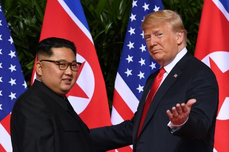 US President Donald Trump (R) meets with North Korea's leader Kim Jong Un at the start of their historic US-North Korea summit, at the Capella Hotel on Sentosa island in Singapore on June 12, 2018