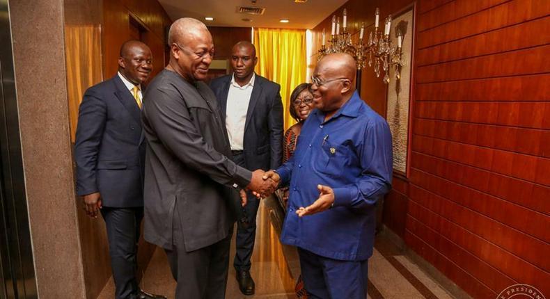 Former president John Mahama and Ghana's president Nana Addo Dankwa Akufo-Addo all smiles