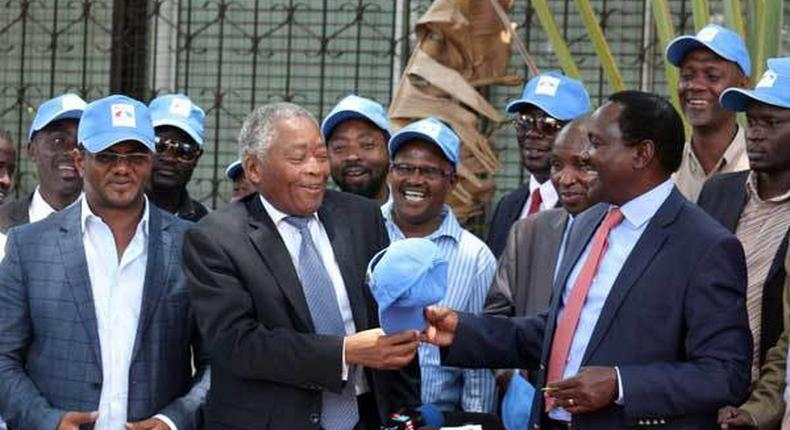 Wiper leader Kalonzo Musyoka (right) received Kwale gubernatorial Aspirant Chirau Ali Mwakwere at the party's headquarters in Lavington, Nairobi, on March 2, 2017.