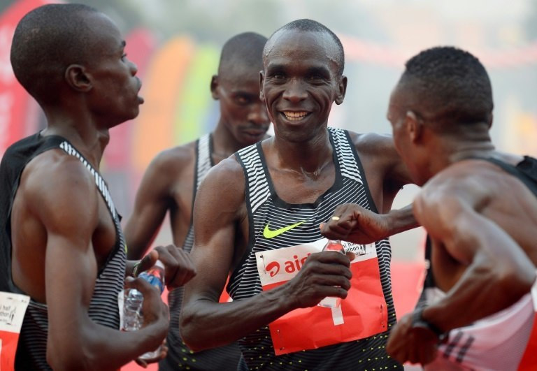 Kenyan Olympic gold medallist marathon runner Eliud Kipchoge (C) is one of three top runners selected by Nike to make the marathon record attempt later this year
