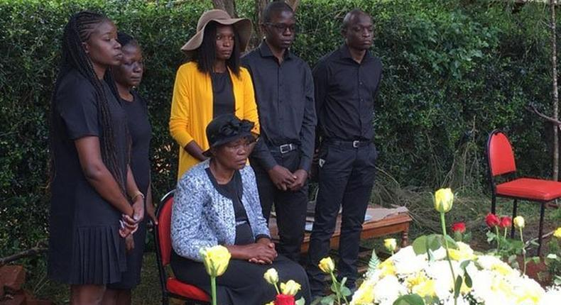 Family beside the grave of Kenya's first Coronavirus victim, the late James Oyugi