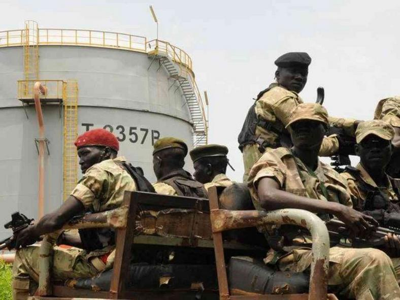 South Sudan's security forces patrol the Dar Petroleum Operating Company oil production field.