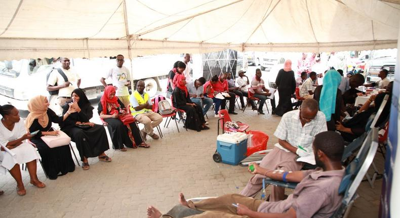 People donating blood at a camp set up by Red Cross during Dusit attack