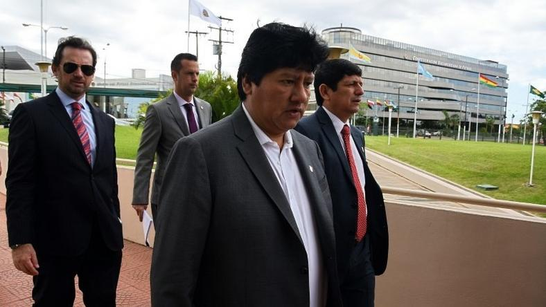 Peru's Football Federation chief Edwin Oviedo (C), pictured in 2015, was detained in an early morning raid on his home in Lima
