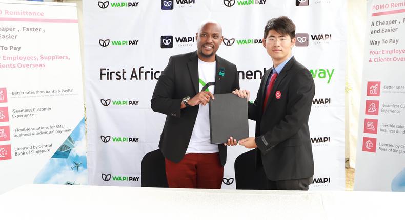 Wapi Capital Exec Dir Paul Ndichu and Fomo Pay Co-Founder Zack Yang at the signing. (courtesy)