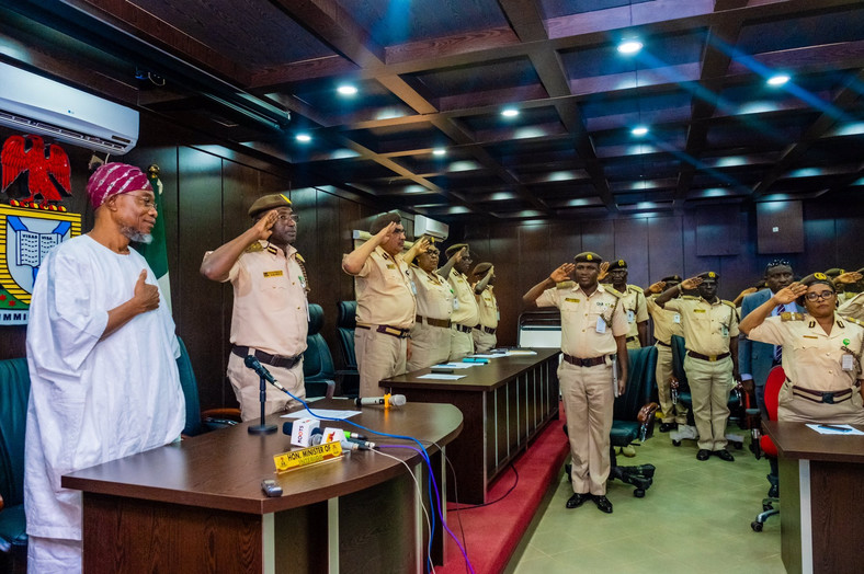 Minister of Interior, Rauf Aregbesola with immigration officers soon after his swearing-in (Ministry of Interior)