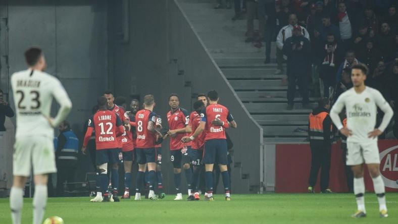 Paris Saint-Germain stand in stunned disbelief as Lille celebrate during their 5-1 win over the Ligue 1 leaders
