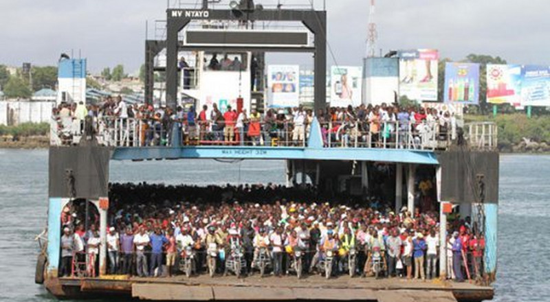 Business as usual at Kenya's Likoni Channel as commuters jostle for space amidst coronavirus pandemic silently grinding Kenya to a halt