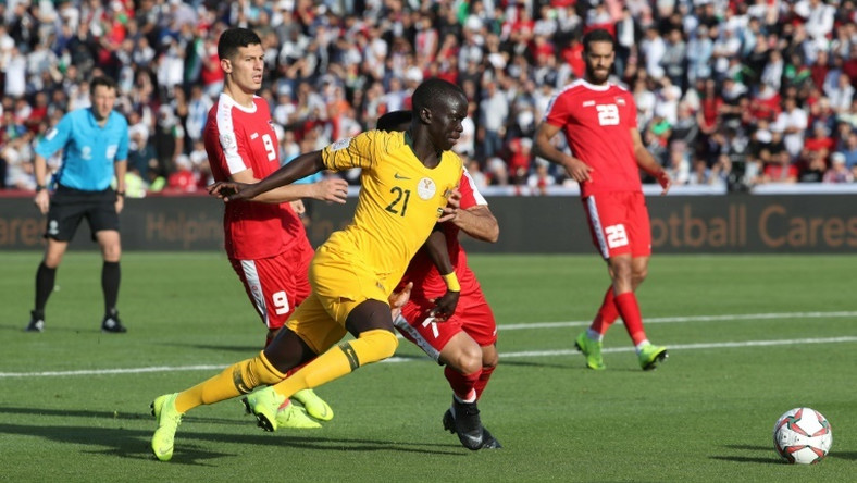 Australia's Awer Mabil scores as the Socceroos beat Palestine to keep their hopes of a last 16 place alive