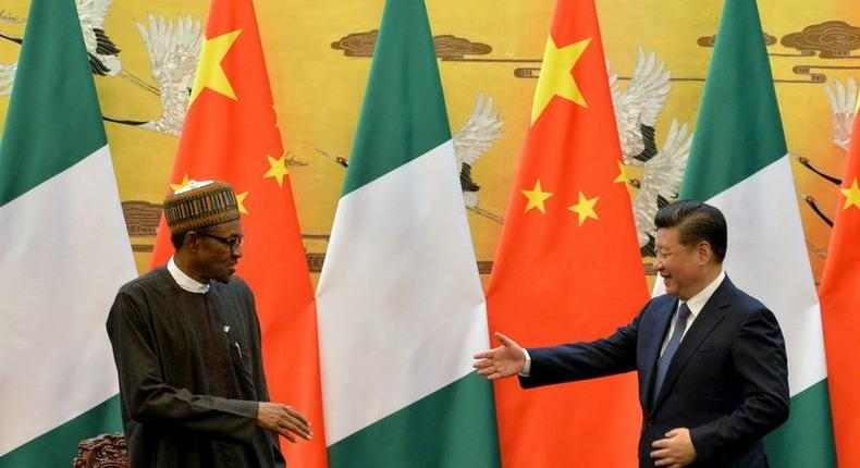 President of the Federal Republic of Nigeria, Muhammadu Buhari (L) and Chinese President, Xi Jinping shake hands during a signing ceremony at the Great Hall of the People in Beijing, April 12, 2016. REUTERS/Kenzaburo Fukuhara/Pool