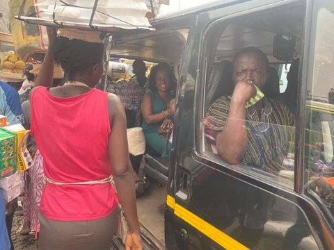 Comfort Doyoe Cudjoe Ghansah sits in trotro