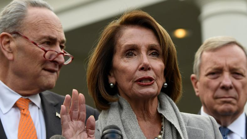 House Speaker Nancy Pelosi of Calif., center, speaks about her oath of office as she stands next to Senate Minority Leader Sen. Chuck Schumer of N.Y., left, and Sen. Dick Durbin, D-Ill., right, following their meeting with President Donald Trump at the White House in Washington, Wednesday, Jan. 9, 2019. (AP Photo/Susan Walsh)
