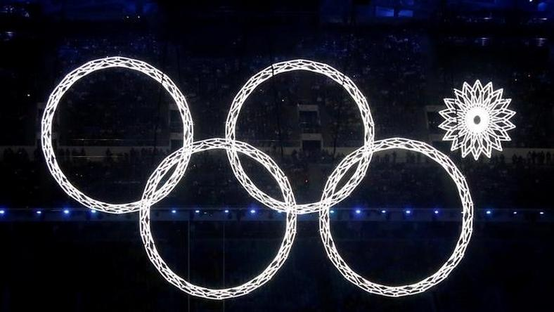 Four of five Olympic Rings are seen lit up during the opening ceremony of the 2014 Sochi Winter Olympics, February 7, 2014.