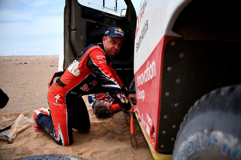 Driver Giniel De Villiers, of South Africa, and co-driver Dirk Von Zitzewitz, of Germany, work on th