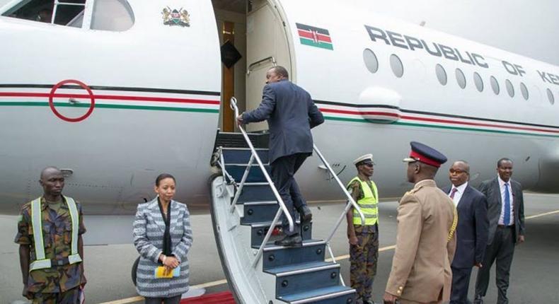 President Uhuru Kenyatta boarding a plane. (Hivisasa)