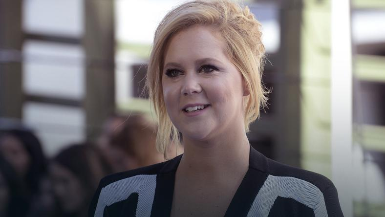 Amy Schumer arrives at the 2015 MTV Movie Awards in Los Angeles