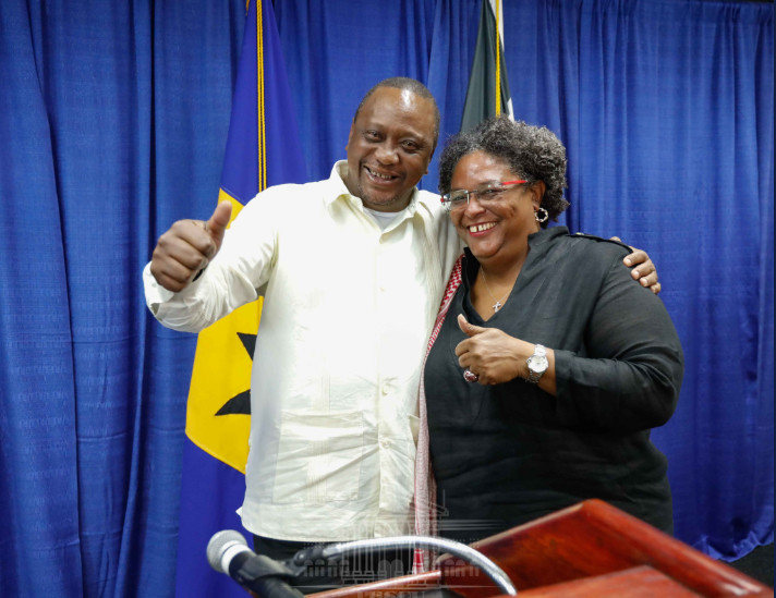 President Uhuru Kenyatta with Barbados Prime Minister Mia Amor Mottley give a thumps up.