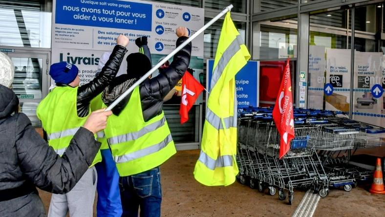 "About 30 ""yellow vest"" protestors joined striking employees at a hardware store in Englos, northern France, on Friday who were seeking higher pay"