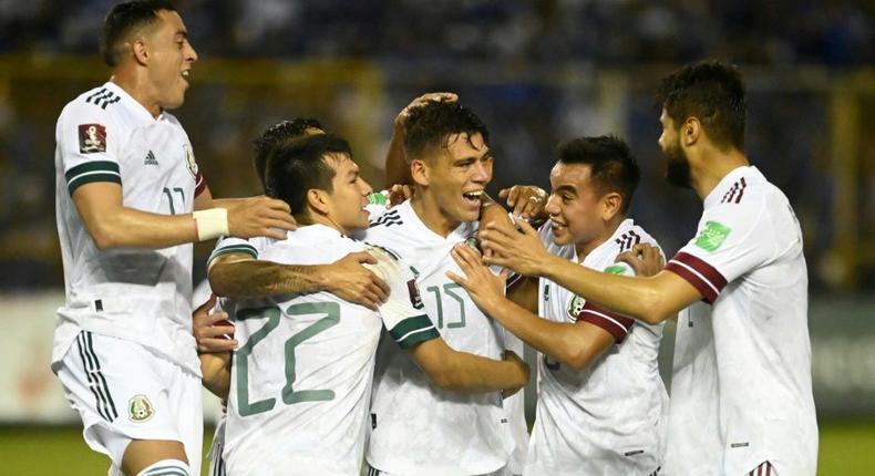 Mexico's Hector Moreno celebrates with teammates after scoring against El Salvador in a 2-0 World Cup qualifier in San Salvador Creator: MARVIN RECINOS