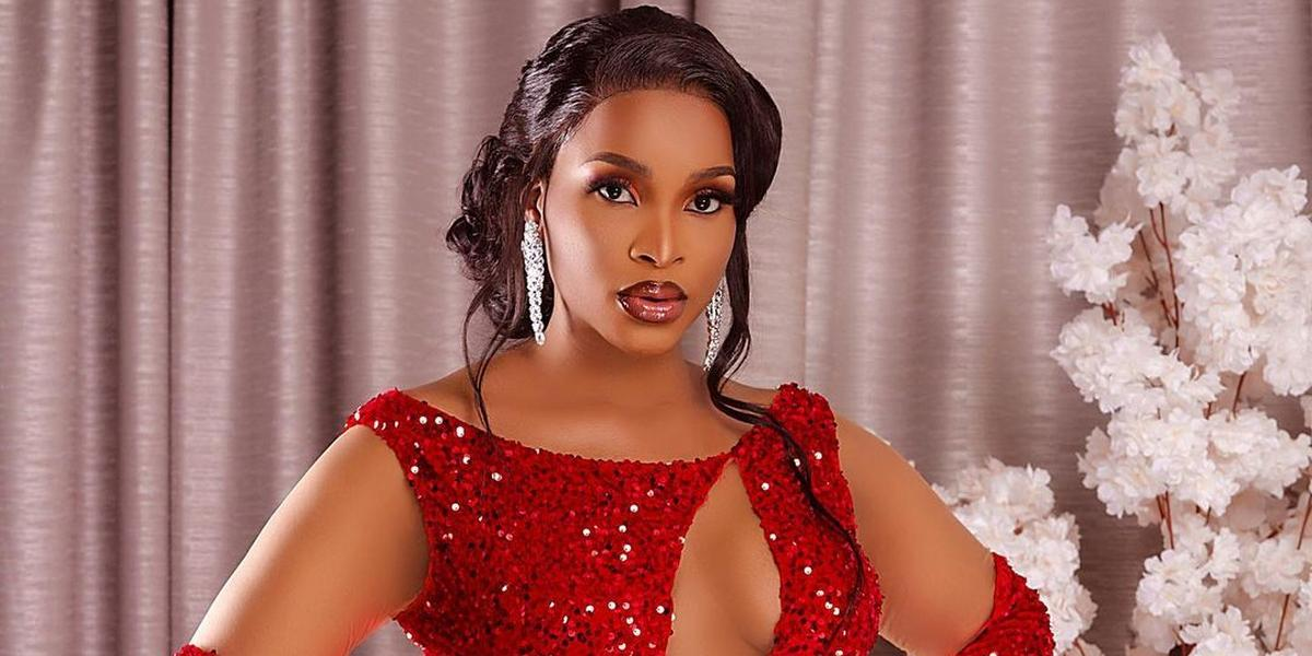 Stunning: Benedicta Gafah is impeccably dressed in red sequin
