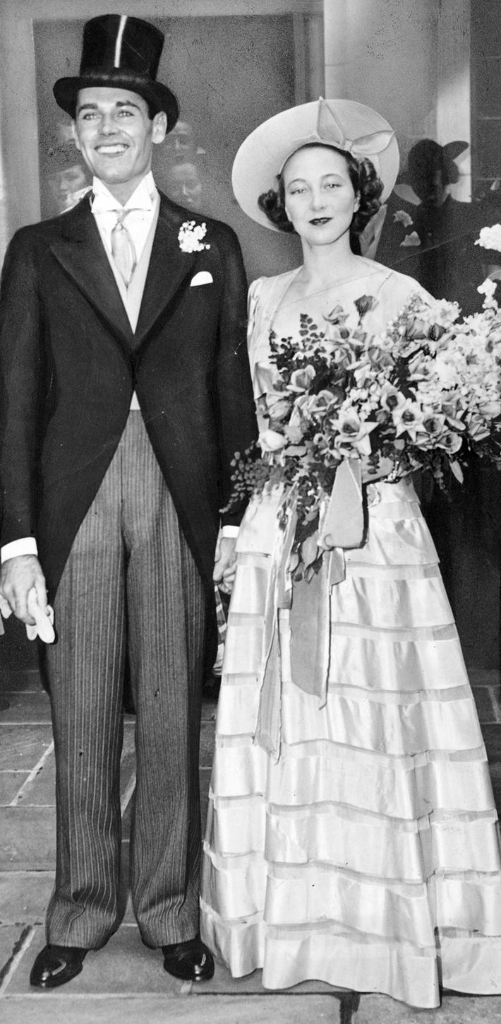 Smiling happily, movie actor Henry Fonda and bride Frances S