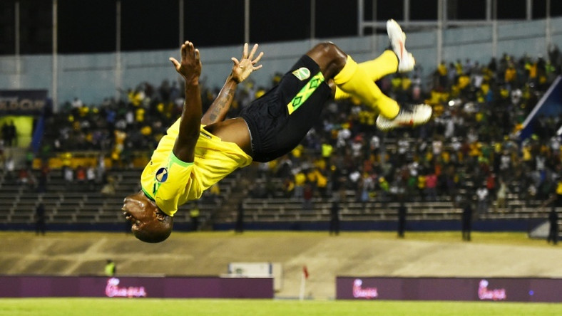 Jamaica's Dever Orgill celebrates his goal against Honduras with a somersault