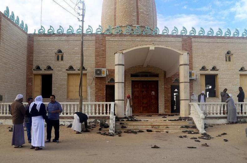 People stand outside Al Rawdah mosque, where a bomb exploded, in Bir Al-Abed, Egypt November 25, 2017.