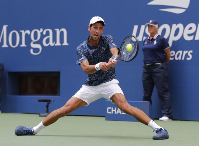 Novak Đoković tokom meča 1. kola US Opena protiv Martona Fučoviča