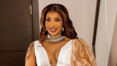 Benedicta Gafah looks chic in an all-white look with gold accessories