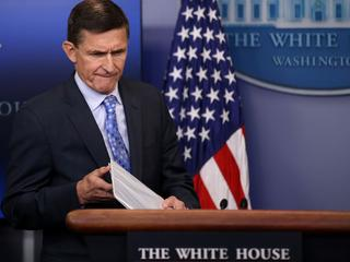 National security adviser General Michael Flynn (L) arrives to deliver a statement next to Press Sec