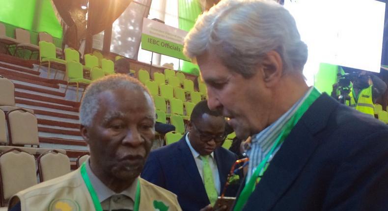 John Kerry consulting Former SA President Thabo Mbeki