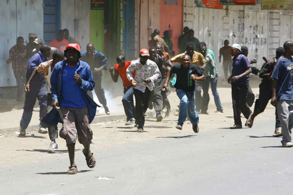 Hawkers dispersing after being tear gased