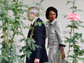 U.S. Secretary of State Rice walks with White House Chief of Staff Bolton at the White House in Wash