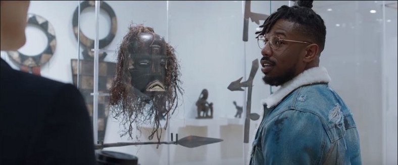 Killmonger in a British museum listening to a white female guide telling him about African artifacts
