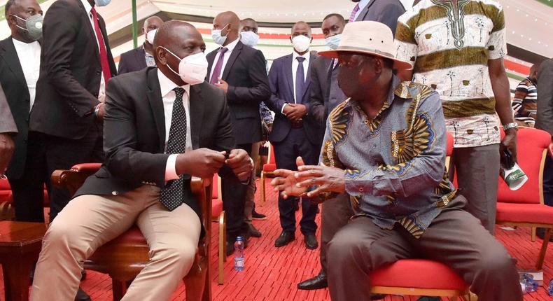 Deputy President William Ruto with former Prime Minister Raila Odinga