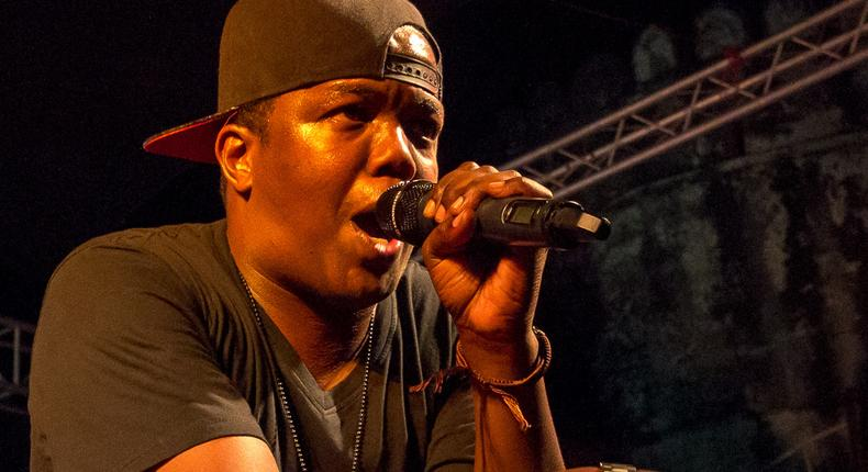 Tanzanian rapper AY on stage at a past performance