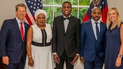 MC Oluomo and son honour invitation from governor of Georgia, USA