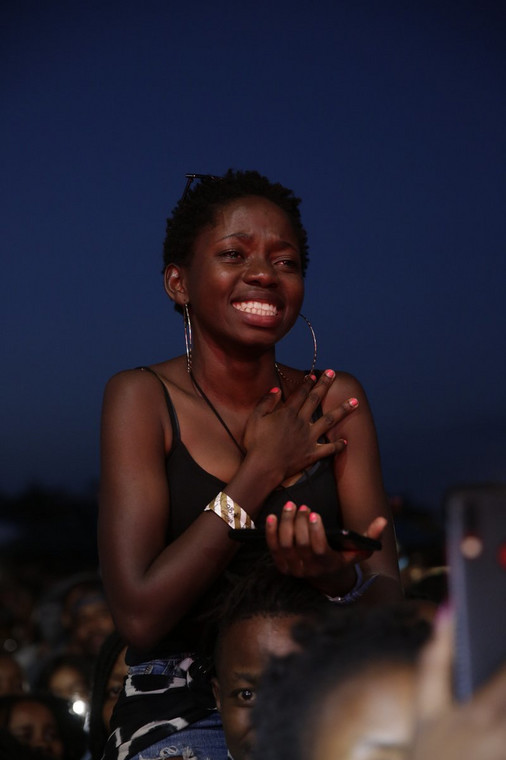 A reveler getting emotional while Asa performs (Image by Capital FM Kenya)