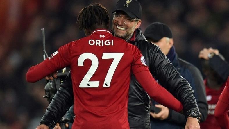 Liverpool manager Jurgen Klopp embraces foward Divock Origi after his late winner against Everton