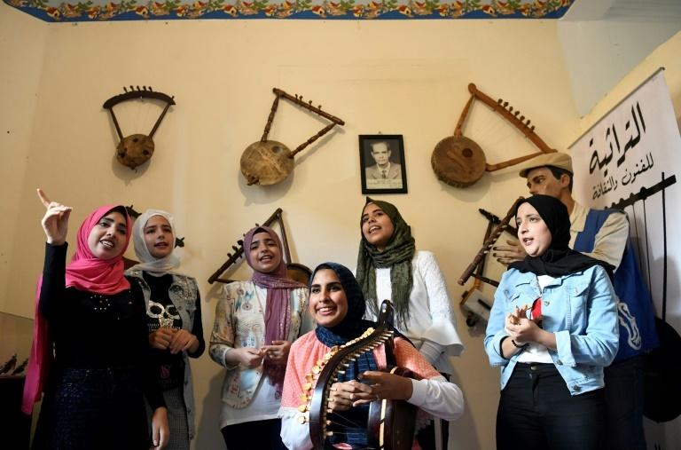A year ago, Iman Haddo (C), started the Arab world's first all-female semsemia choir called Amwag (waves).