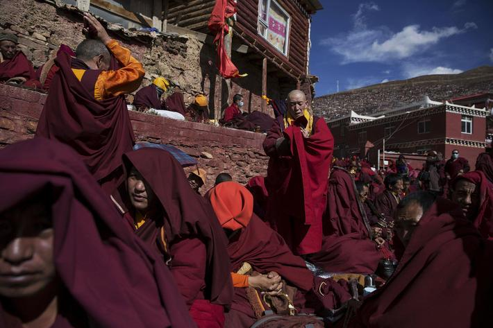 Tibetan Buddhist monks pray at Buddhist laymen lodge during the Utmost Bliss Dharma Assembly in remo